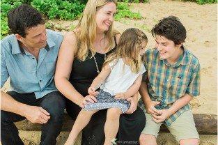 Family of four laughing-Kauai Beach photo session